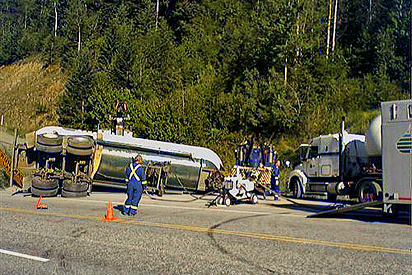 tanker truck rolled over on the side of the highway