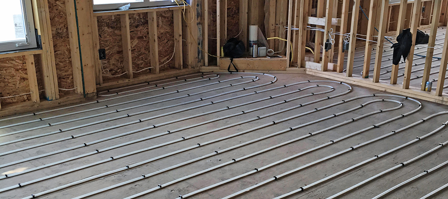 In-floor heating pipe laid out inside a home under construction.