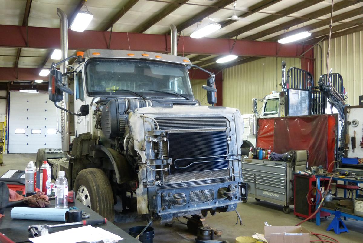 Semi truck getting repaired.