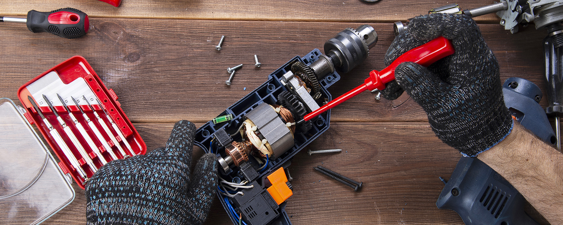 A electric drill with the cover off being repaired