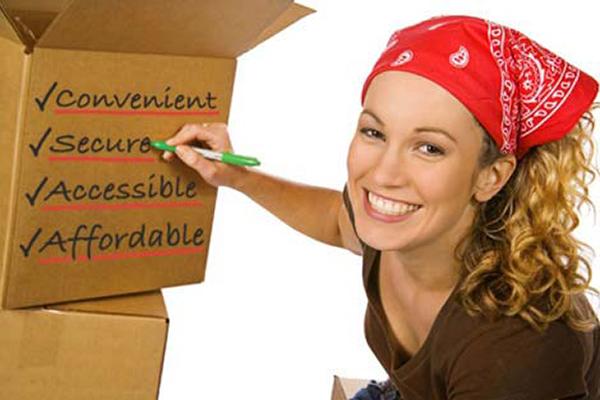 A lady writing on a box