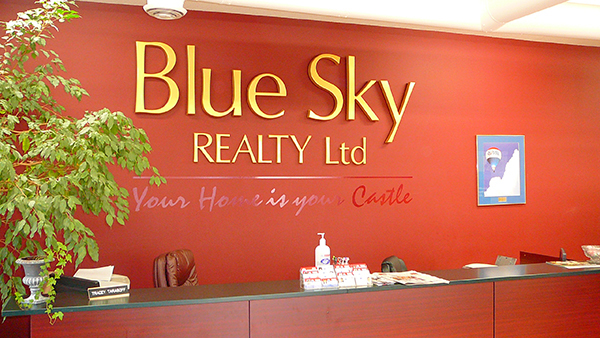 Inside office reception displaying Blue Sky Realty Limited Your Home is Your Castle