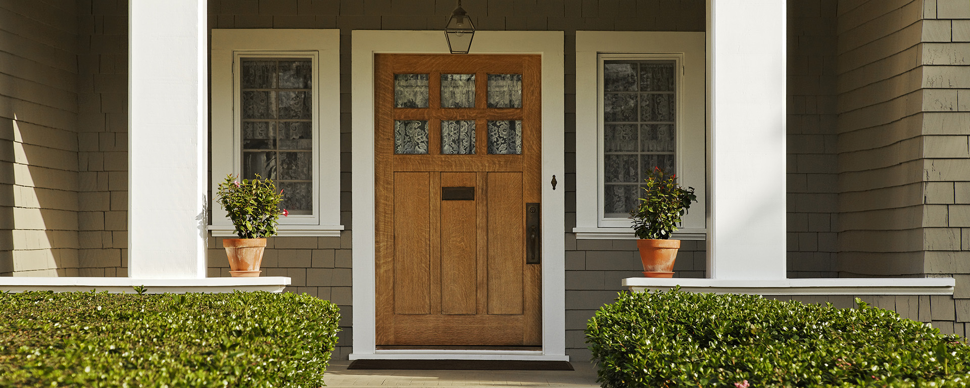Mahogany colored door on front porch.