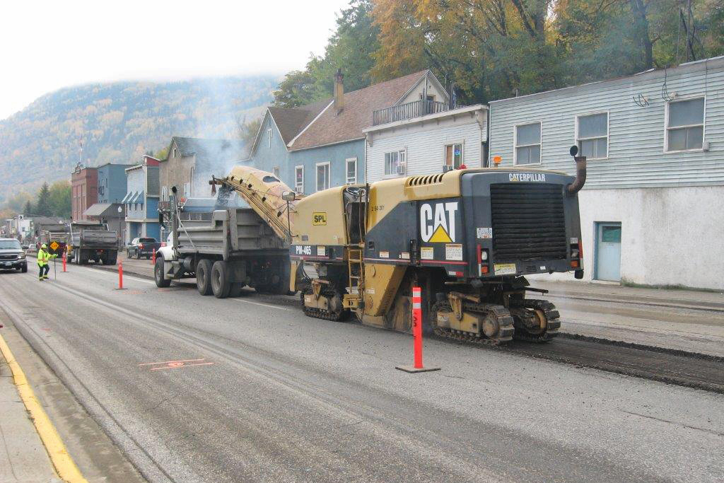 heavy equipment paving a new road in town