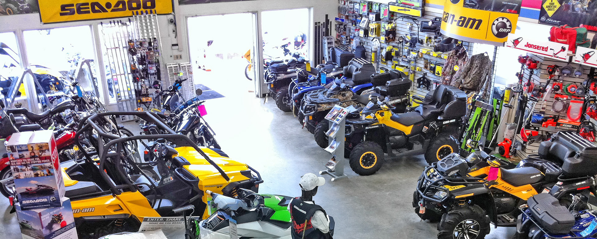 ATVs, side-by-sides and motorcycles on display within store at Playmor Power Products