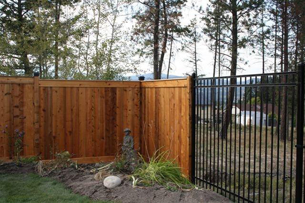 Vertical wooden fencing around property