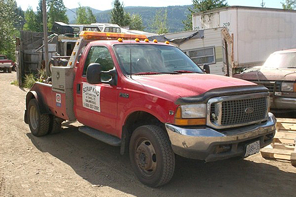 red truck advertising Scrap King Auto Wrecking and Towing