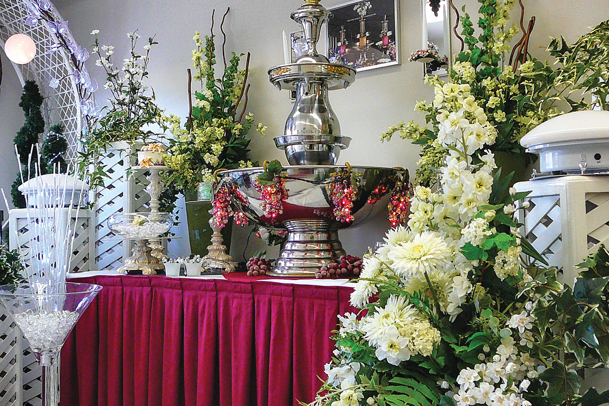 Wedding and party supplies including floral arrangements and vases