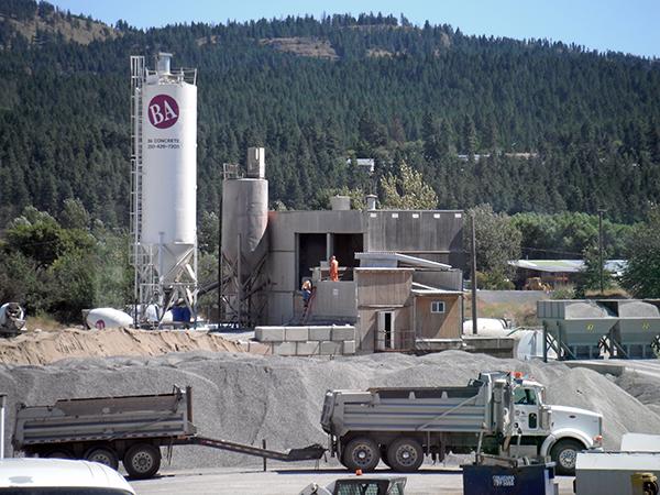 Semi trucks working onsite hauling gravel