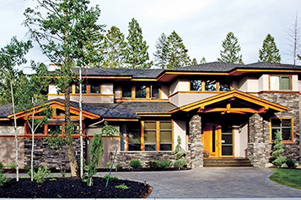 Showhome with cedar trim and rock work on front of home