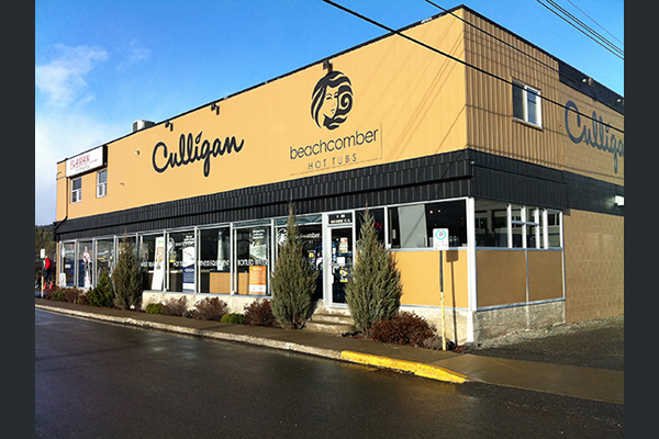 Exterior of building displaying signs saying Culligan and Beachcomber Hot Tubs