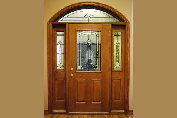 Maple coloured front door with specialty side lights