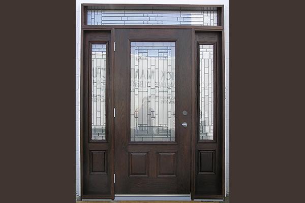 Dark front door with specialty sidelights