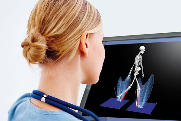 Lady observing skeletal images on the computer screen