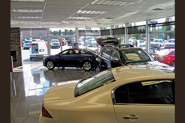 Cars parked inside showroom of dealership