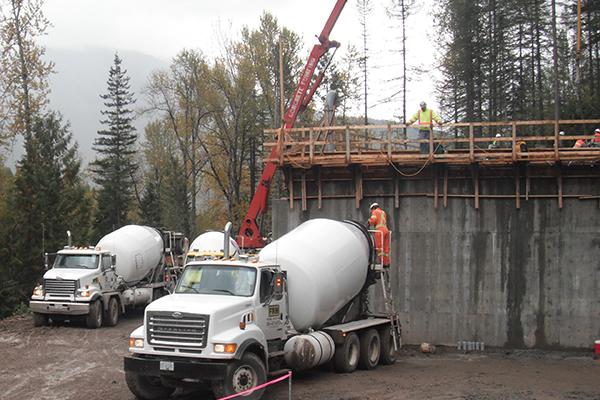 White semi truck hauling a concrete mixing tank