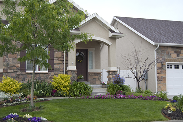 exterior of a showhome displaying the roof and shingles
