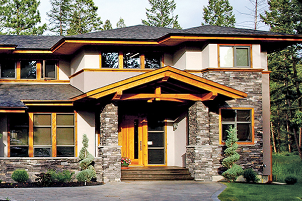 Showhome with cedar trim and rock work on the front of the home