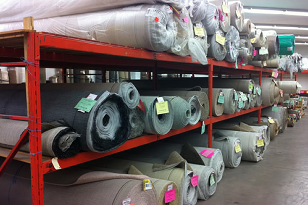 Rolls of carpet stored in inventory at Cranbrook Flooring