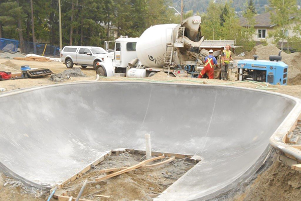 a construction site with a gravel truck parked on site