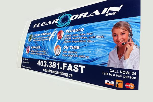 White company van advertising Clear Drain plumbing