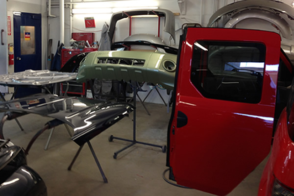 Vehicle parts in a shop being refinished and repainted