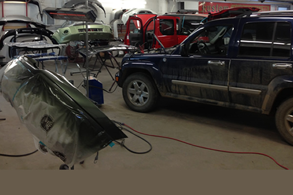 Vehicles in the shop at Kustom Auto Body