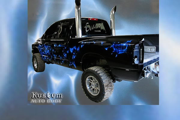 lifted black truck with bright blue customized paint design