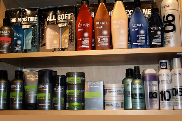 Hair product on shelves displayed at Waves On The Lake Hair Design