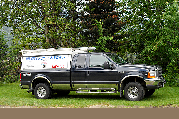 Company truck advertising Tri City Pumps and Power