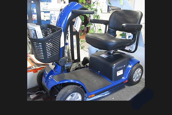 black, gray, and blue motorized scooter