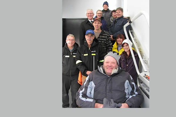 Group of staff members that work for Kootenay Columbia Home Medical Equipment posing in a stairwell