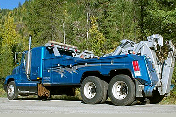 Blue utility truck parked on the highway