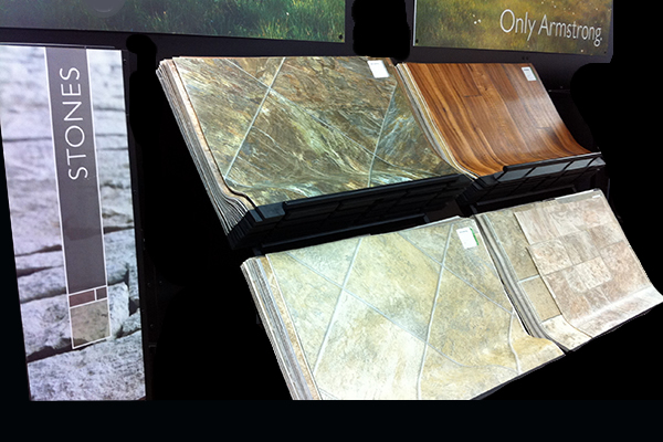 Samples of laminate flooring and stone selections