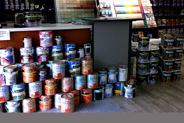 Cloverdale paint and cans of stains and primers