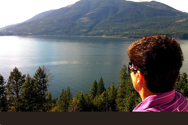 Head shot of a lady overlooking Kootenay Lake