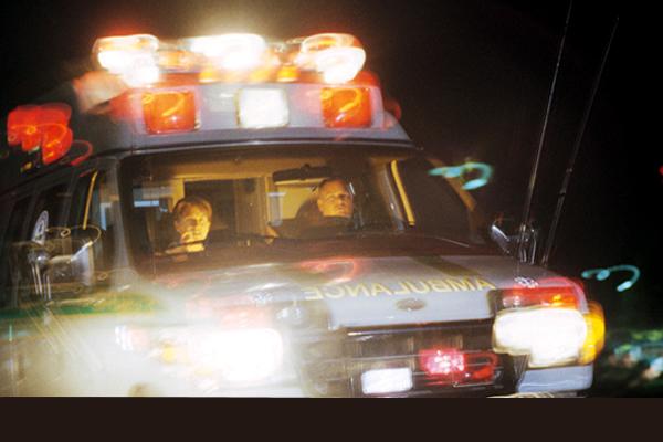 An ambulance driving with lights flashing