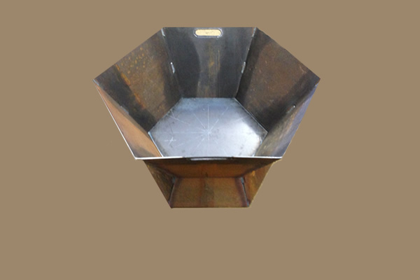 ornamental steel welded into a hexagonal bucket