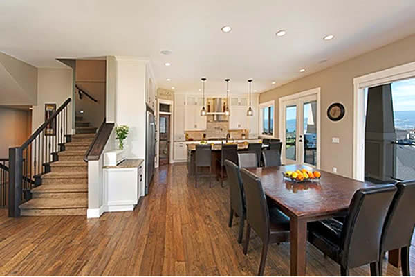 interior of a show home displaying a staircase and open dining area
