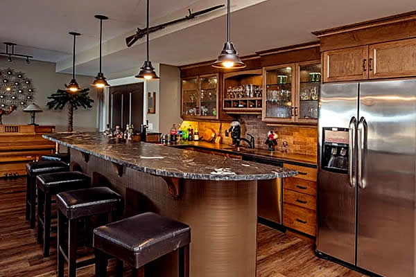 Warm tones in an open concept dining area with bar seats at an island