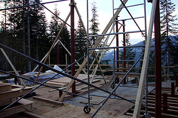 metal scaffolding set up outside with mountains in the background