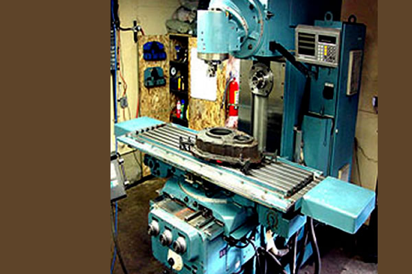 turquoise coloured drilling machine for metal