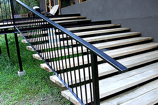 outside residential staircase with black metal railing