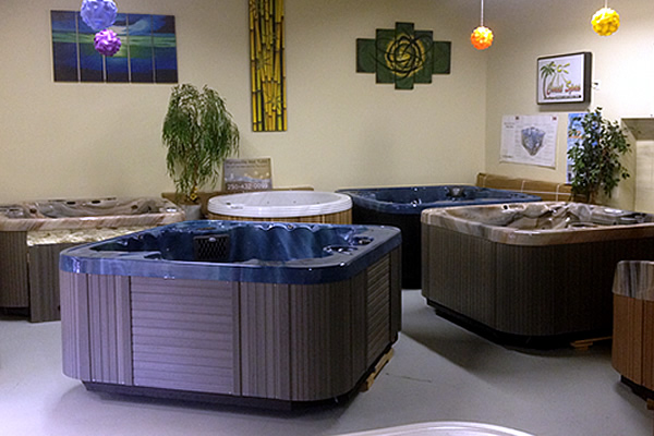 two hot tubs on display within store