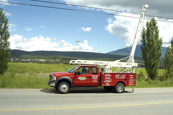 Red utility truck with white crane