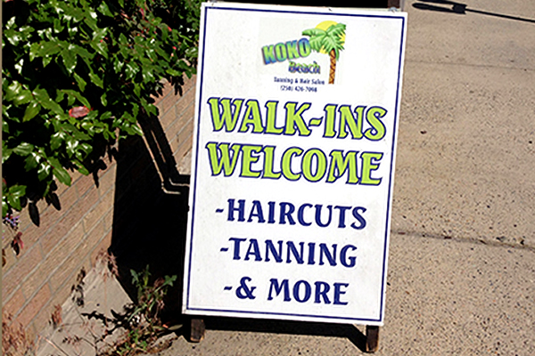 Sandwich board sign listing services offered