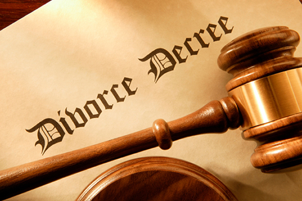 Divorce Decree paper with a gavel laying over top of it