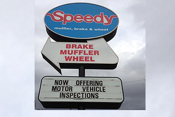 exterior signs advertising Speedy Muffler, Brake and Wheel