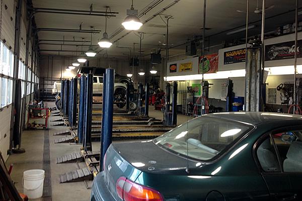 Inside the garage section at Speedy Brake, Muffler & Wheel