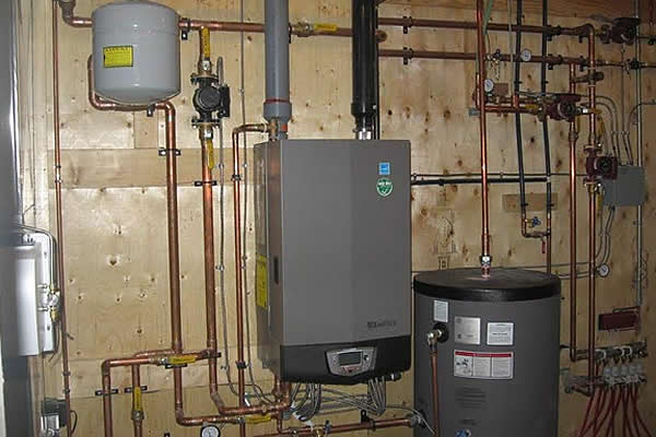 copper pipes connected to a hot water tank in a residential house